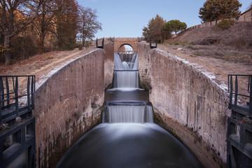 Waterfall in Touristic attraction Canal de Castilla, famous landmark in Palencia, Spain.