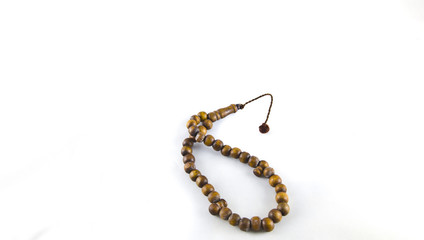 A Brown Rosary on White Background ısolated