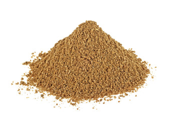 Pile of ground coriander on white background, indian spice