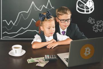 Smart children buying bitcoin cryptocurency