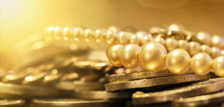 Pearls and gold coins - web banner of wealth, luxury concept
