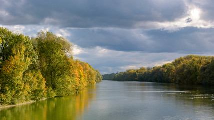 Isar in Munich in autumn with sunlight.