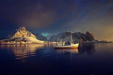 fishing boat and Reine Village, Lofoten Islands, Norway