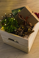 Christmas decorations in a wooden box on a wooden table
