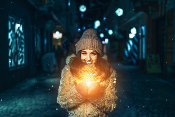 Pretty happy girl hold colorful lights in hands outdoor Fotomurales