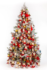 Christmas tree with red ornaments. Christmas tree for the new year. Christmas tree decorated with bears.