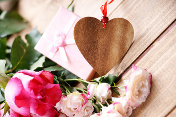 Roses, gift box and wooden heart shape
