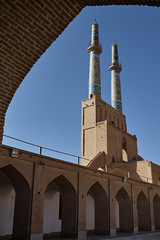 Friday mosque from under arch of entrance gate, Yazd, Iran.