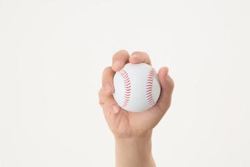 野球のボールを握る手