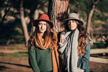 Teenager girls with autumn outfit in the forest