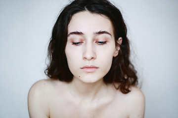 Melancholy portrait of young woman with minimum make up