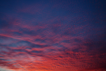 Beautiful sky with red broken clouds.