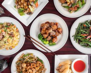 Sesame chicken, fried rice, shrimp and tofu in Chinese retaurant
