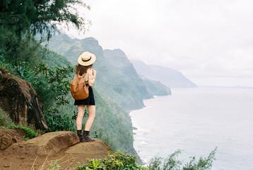 Woman hiking along coast