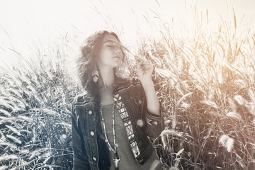 cheerful young woman outdoors at sunrise