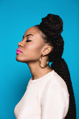 Portrait of a young african American woman with dreadlock.