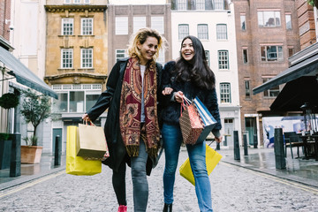Young Female Best Friends Doing Shopping  on the Streets.