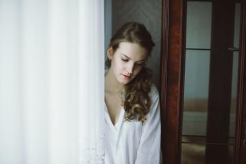 sensual young beautiful young girl in a shirt