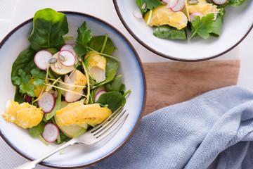 Smoked haddock,spinach and potato salad bowls.