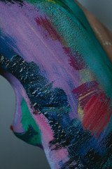 Closeup view of skin covered with colorful cracked paint