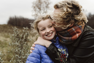 Outdoor portrait of mother and daughter together