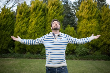 Man standing with arms wide open