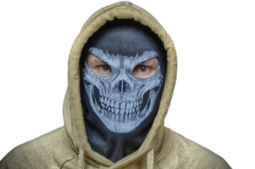 Man in balaclava skull mask and hood, maybe halloween costume (robber, burlgar, snatcher, terrorist or evil anonymous) with white back. Isolated image