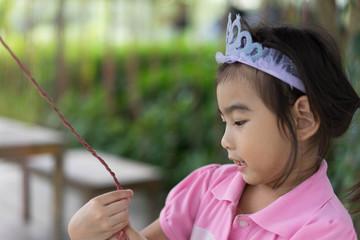 Asian cute little girl Playing Crown princess