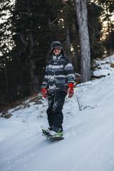 Man riding snowboard