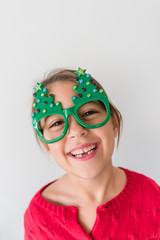 Girl Wearing Christmas Tree Glasses