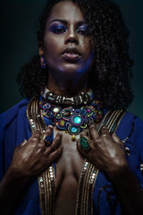 Beauty style portrait of black african model wearing colorful jewelry accessories