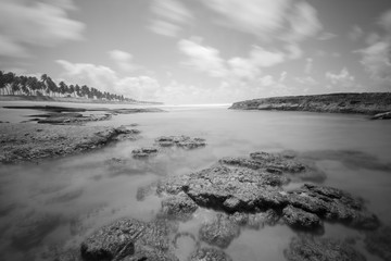 Long exposure photo of beach with rocks (black and white)