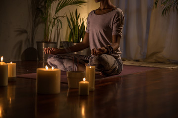 Woman peacefully meditating on a summer evening