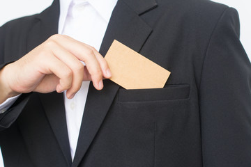 Part of body of business man who takes out business card from the pocket of business suit