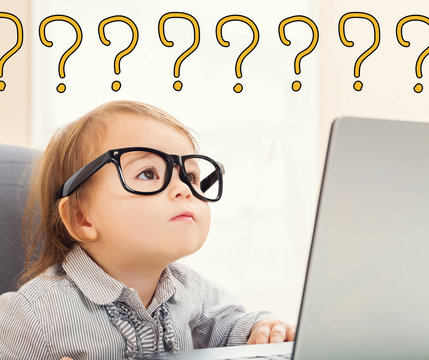Question Marks text with toddler girl using her laptop