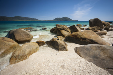 Granite boulders and coral sands on a secluded beach on Fitzroy Island, near Cairns, Far North Queensland.