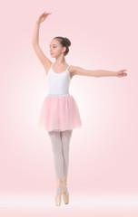 little ballerina on a pink background