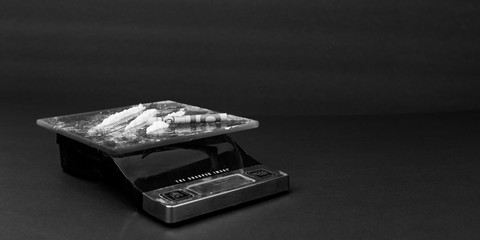 Image representing cocaine on a scale for sale and consumption