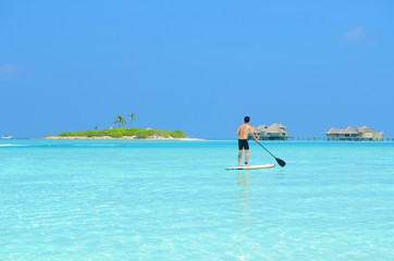 paddle board at maldives island