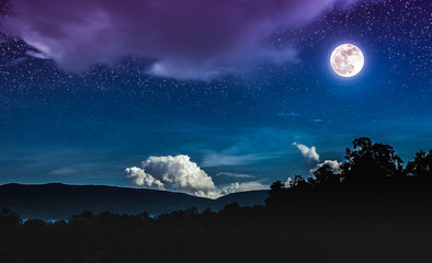 Landscape of blue night sky with many stars and beautiful full moon.