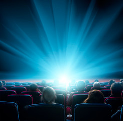 viewers watch shining light in the cinema