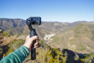 A steadycam with action camera