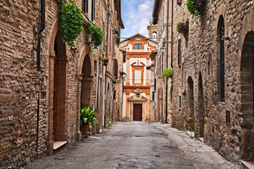 Bevagna, Perugia, Umbria, Italy: alley and church in the old town Wall mural