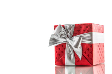 Christmas valentine or birthday red gift box with silver ribbon isolated on white
