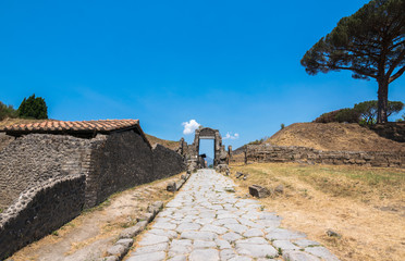 Walking around the ruins and the empty streets of the ancient antique site of Pompeii destroyed by Mount Vesuvius in AD 79, Naples, Campania, Italy, Europe