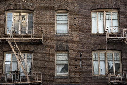 windows and fire escape old city tenement brick apartment building