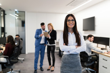 Portrait of young businesswoman posing in office