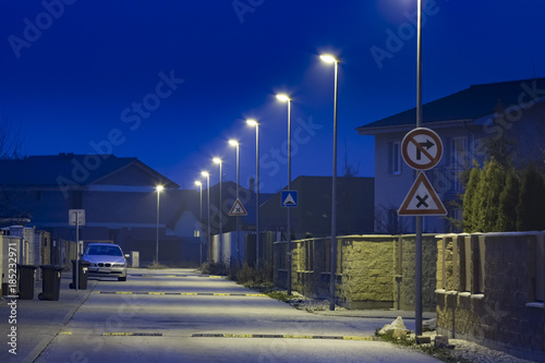 Modern Residential Street At Night Wit LED Street Lights