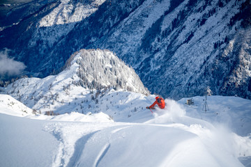A male skier skiing in powder snow at the Kitzsteinhorn Glacier near Salzburg in Austria. Fotobehang