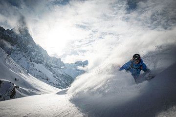 A skier does action skiing at the Rolle Pass in the Dolomites, Italy.